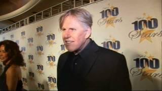 Gary Busey gets weird on Oscars red carpet