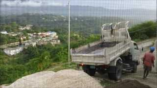 Isuzu Dump Truck Tipping Of Aggregates On Tricky A Hill