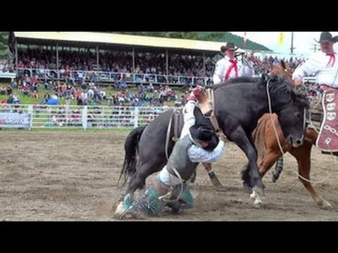 RODEO MISHAP!! - Cowboy dragged by Bronc!! - Falkland Stampede 2011