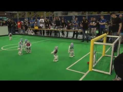 Robot Footballers On The Pitch At RoboCup