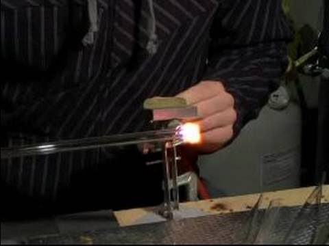 Glass Blowing Basics : How to Round Out a Tube with Glass Blowing