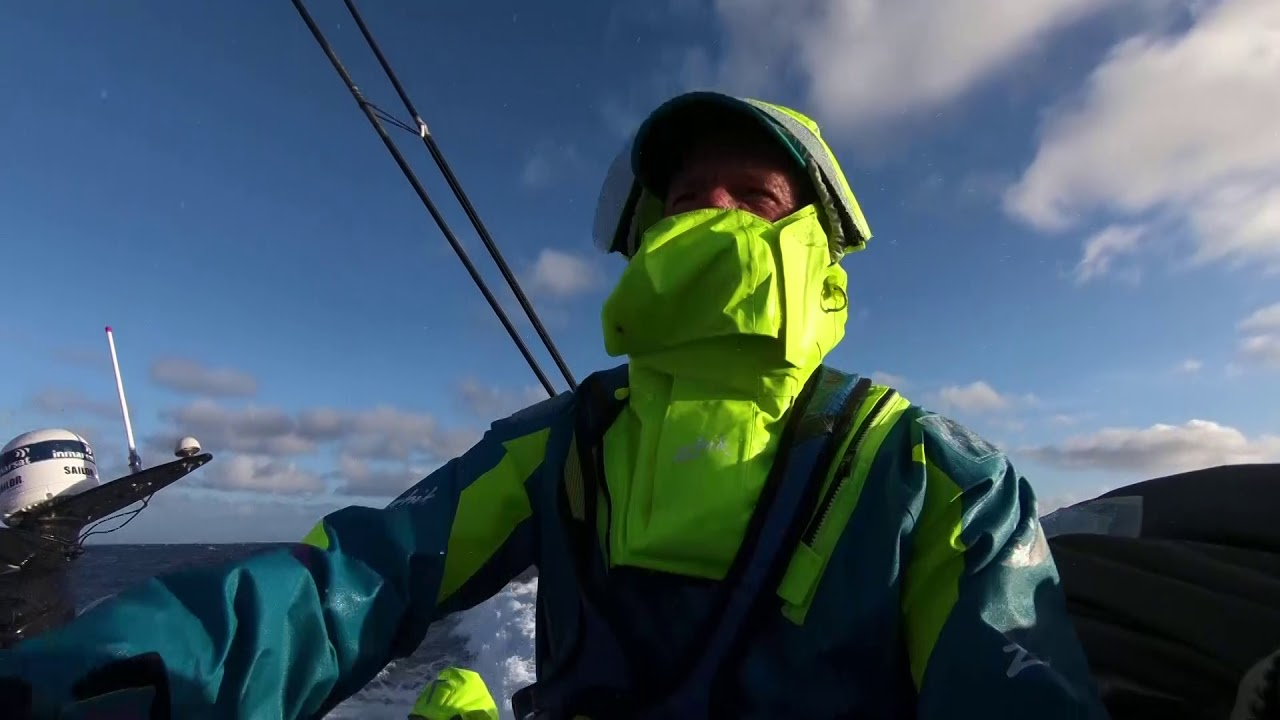 "Nicolai handles a sheet, takes spray. He talks about J0 vs. MH0. Talks about how it's good getting south; he doesn't mind the cold. ""Must be close to Dongfeng though?"" Slomo spray. Surfing fast with Nicho on the helm. ""A week of pretty full on with 30 to 40 knots, maybe gybing along the ice gate. Need a bit of gybing practice anyway I reckon. Be all right this time. I was doing plenty of gybes coming into Auckland with everything up. Won't be doing that bit of drama again, guaranteed. Slomo washing machine. Martine below getting her foulies on, stretches her neck. ""It's already pretty wet, and we haven't even got there... It's not going to be easy, but looking forward to the highway that takes us all the way to South America."" Slomo of her taking spray. Favorite mainly because of that brief interview with Nicho talking about gybing."