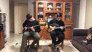 Samuel Burns and Ivan Jovanic playing Electric Guitar