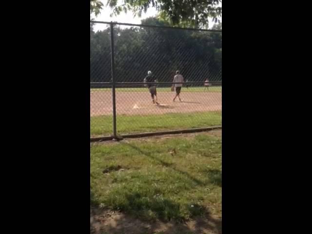 Above Knee Amputee Softball Player RBI Double
