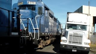 Railroad Running Down middle of BUSY Port Street ! Ex BNSF Santa Fe GP30 !  Street Running !
