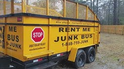 Dropping off a 22 Yard Dumpster Rental  in the rain  New Orleans & Slidell, La