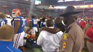 Florida coach Jim McElwain walks off the field after a 42-7 loss to Georgia