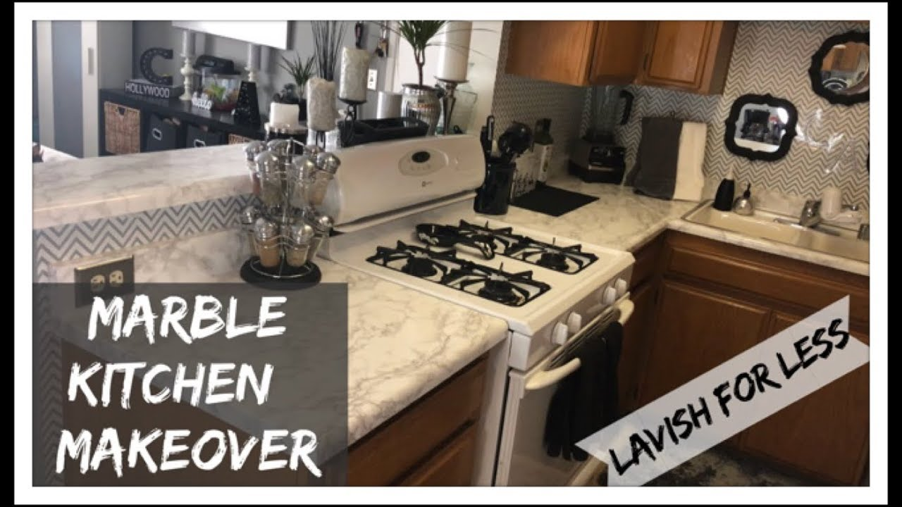 kitchen makeover marble counters and chevron backsplash