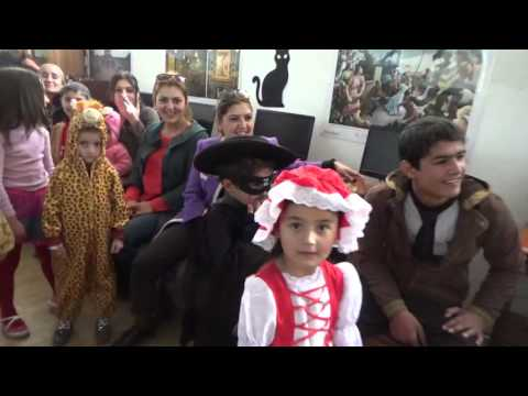 Khorog, Tajikistan   Cookie on face contest, from behind   Children in costumes