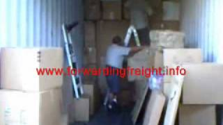 Stuffing Loading Household into 40ft container - international moving Company