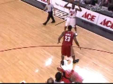 Luol Deng crosses LeBron James