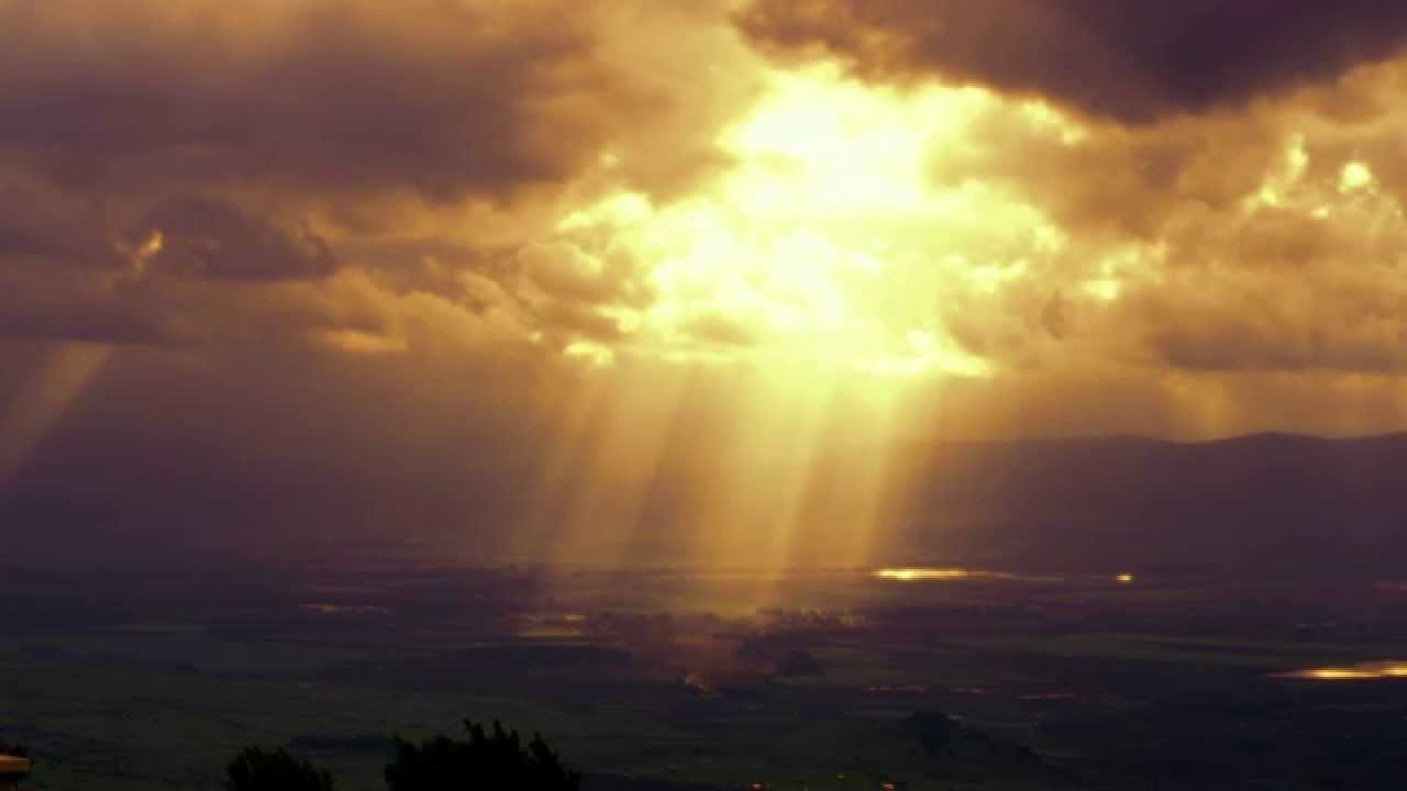 Stock Video Footage Of Sun Rays Illuminating A Valley