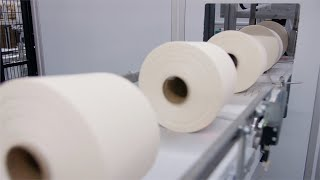 Textile Industry - Closeup shot of the yarn creel spool passing through automatic machine