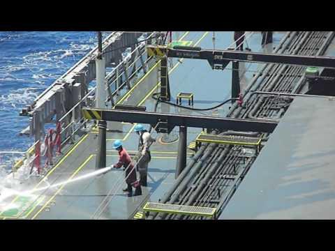 Washing ship's deck