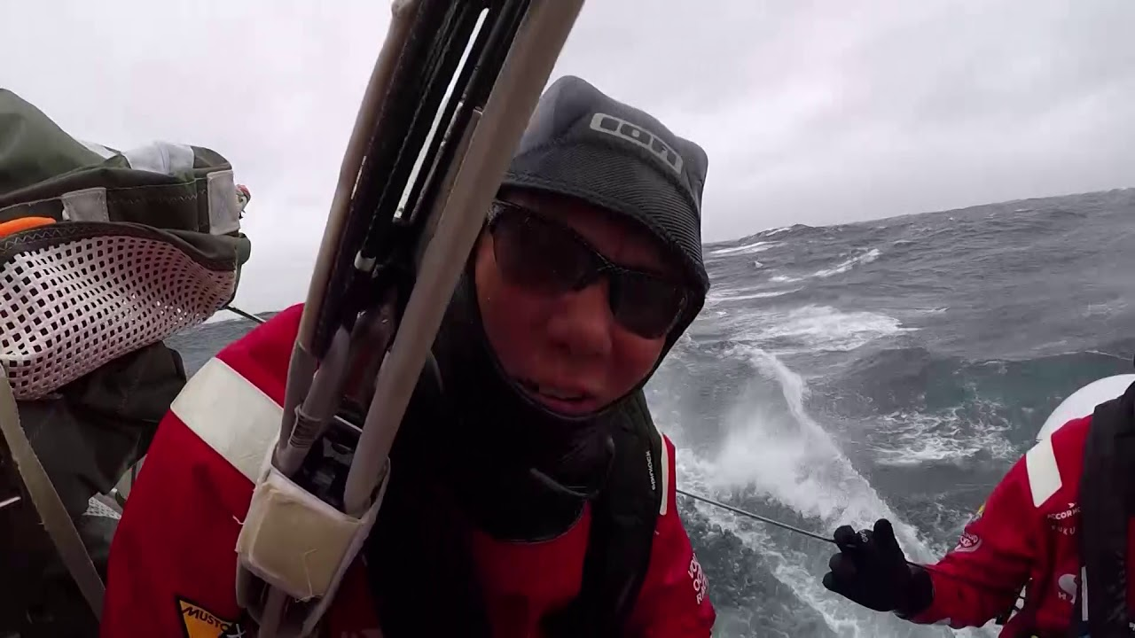 """Scallywag blasting in windy conditions with reefed main / J3. Antonio on the stern: Come and do the Volvo and see the world! He gestures at the waves. Witty at the nav station: Rubbish. We're last again. Three lasts in a row. Plus a did not finish. So basically we haven't got any points since New Zealand. So since we were third on the table we haven't got a point. Reaching on deck. Slomo wake. Witty: In 196 miles I get a cold beer, and a piece of steak I can use a knife and fork with, and I get a cuddle from Lynnie. Anniemieke on the stern rubs her hands. """"If your hands are warm, your head is warm, your heart is warm."""" Witty: 30 years of yachting. I don't think I've ever seen a harsher penalty for one very small error, that could have actually not been an error as well. [Thought at first he was talking about Fish. :-( ] 10 miles maybe, even 50 miles wouldn't have been harsh. But we lost 100 miles the first 6 hours of the race, and we're going to finish 25 miles behind them. Slomo spray, wake. Witty: Quite a lot of traffic coming into Gothenburg, ships and stuff, separation zones. So my job the last two watches has been to sit in front of the computer and make sure we don't run into a tanker. Because that would put the icing on the cake, wouldn't it? Massive seas, raining, can't see 6 foot in front of you. 195 miles to go man. Slomo spray on deck."""