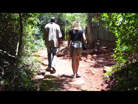 Entering Shangana Village with our Guide.