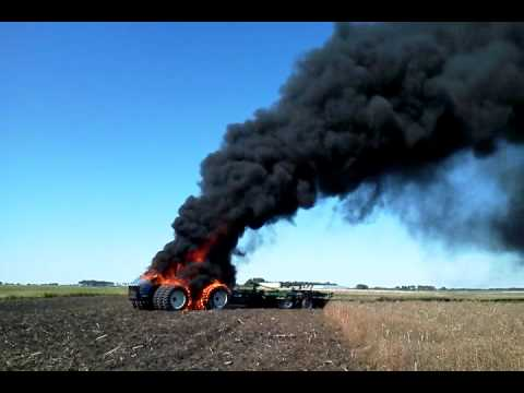 New Holland T9060 on fire - YouTube