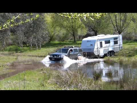 River Crossing, Off Road Caravan RV, Towed By A 4wd Nissan Pathfinder 4x4
