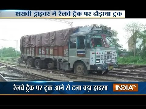 Drunken Truck Driver Drive on Railway Tracks - India TV