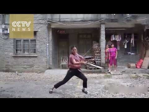 Middle-aged Chinese woman chucks stereotypes with nunchuk skills