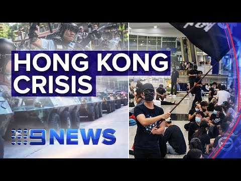 Chinese tanks paraded near Hong Kong border as protests hit airport | Nine News Australia