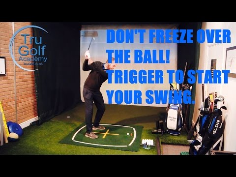 DON'T FREEZE OVER THE BALL – TRIGGER TO START YOUR SWING.