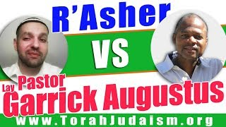 R' Asher speaks with Garrick Augustus