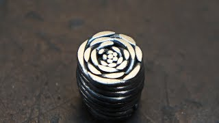 Damascus steel 'Dinosaur Skin', from a plumbing cable.