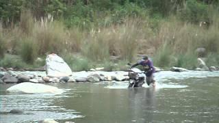 Near Cervantes, Ilocos Sur, pushing the bike across the river