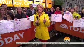 Dylan Dreyer in shiny raincoat - 4-Oct-2014
