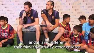 Fc barcelona players meet children with disabilities