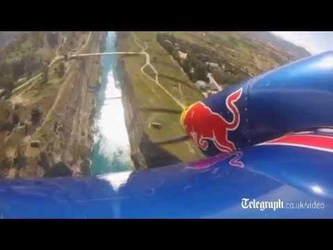 Daredevil pilot shows off skills over Greek canal