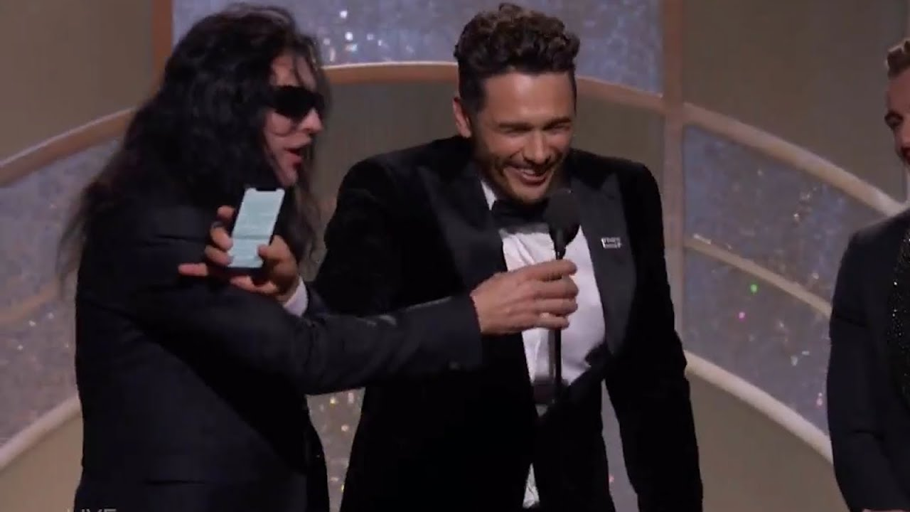 Tommy Wiseau tries to steal mic from James Franco but ...