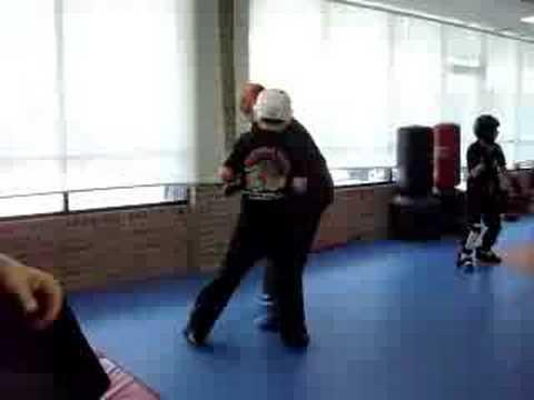 kid beats up adult