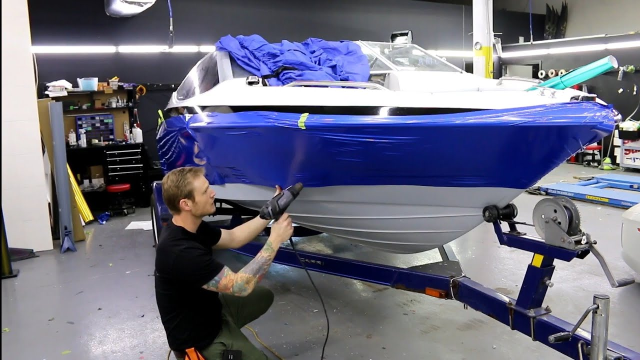 Vinyl Wrap A Boat In Gloss Black And Diamond Blue