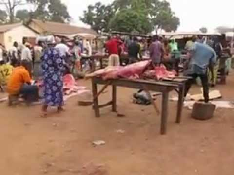 Cutting up Beef in Natitingou Market Benin West Africa