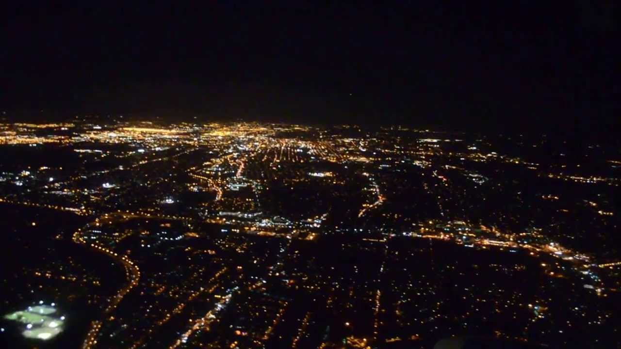 Flying into Newark, NJ at night time with full moon in the back ground