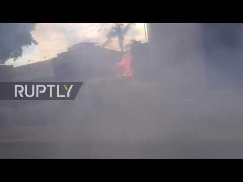 Venezuela: Burning police van rolls through Caracas street during protests