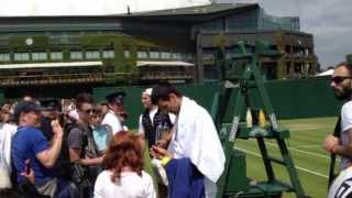 Novak Djockovic giving autographs at Wimbledon Championship