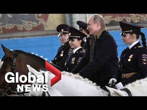Vladimir Putin rides horse with female police officers ahead of International Women's Day