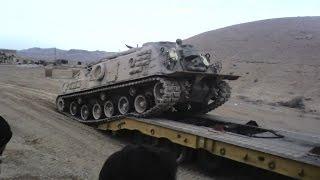 Loading and Unloading M88A1 recovery vehicle from a truck