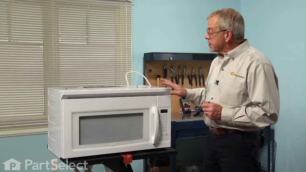 microwave repair replacing the internal light bulb 40w whirlpool part 8206443