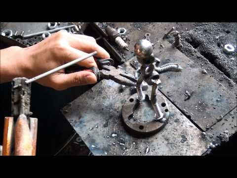 The Saxophone figurine sculpture from scrap metal.