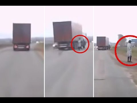 Mysterious Man in Lab Coat 'TELEPORTS' Onto Busy Road Almost Hit by Truck