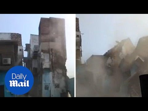 Terrifying moment entire three-storey building collapses in seconds - Daily Mail