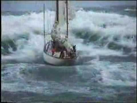 Stormy weather - sailboat in distress at sea