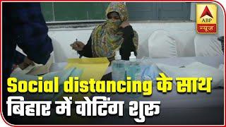 Bihar Polls 2020: People wear …