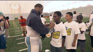 Ndamukong Suh practices with kids at Dolphins' training camp