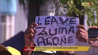 Former President Jacob Zuma addresses his supporters outside Durban court