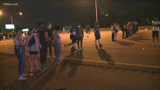 Line of white people form barrier on Atlanta interstate during protest